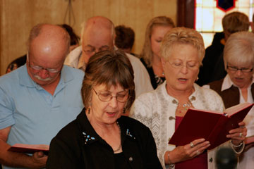 From left, Russell Bott, Elvina Rockeman, Marilyn Bott and Cheryl Knecht worship at the Donnybrook United Methodist Church. A UMNS photo by Jan Snider.