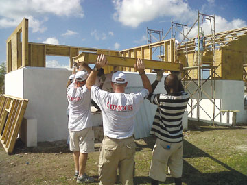 Workers from the United Methodist Committee on Relief, the Methodist Church of Haiti and United Methodist Volunteers in Mission help erect a Habitat for Humanity home in Leogane, Haiti, in November 2011. A UMNS photo courtesy Habitat for Humanity.