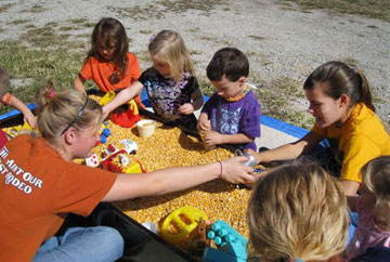 Children play in a corn box at the Harvest Celebration of Oxford United Methodist Church and First Christian Church of Lafayette, Ind. A web-only photo courtesy of Don Johnson.