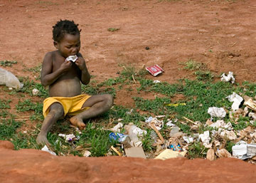A child scavenges for food in a garbage pit near Malanje, Angola. Advocates working to end hunger say enough food is produced globally to adequately feed everyone around the world. A UMNS photo by Mike DuBose.