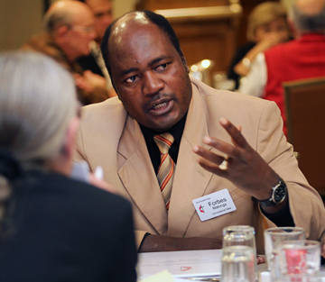 The Rev. Forbes Matonga of Zimbabwe makes a point during a meeting of the Connectional Table. A UMNS photo by Kathleen Barry.