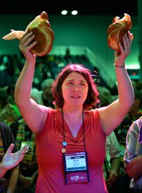 The Rev. Becca Clark participates in communion May 3 during the 2012 General Conference as part of a protest demanding a more inclusive church. A UMNS photo by Paul Jeffrey.