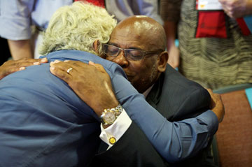 Receiving a congratulatory hug is newly elected Bishop L. Jonathan Holston (right), elected on July 18 on the first ballot at the Southeastern Jurisdictional Conference. Photo courtesy of Lake Junaluska Conference and Retreat Center.