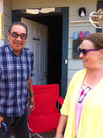 JuDee Anderson (right) visits with Charles Little Old Man, a spiritual leader on the reservation.