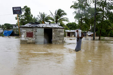 A resident of a low-lying area of Port-au-Prince, Haiti, flees his flooded home. Web-only photos courtesy of United Nations /Logan Abassi