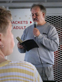 The Rev. Erik Alsgaard leads the Vesper worship by reading the creation story to the 221 passengers aboard the Arnold Ferry boat.