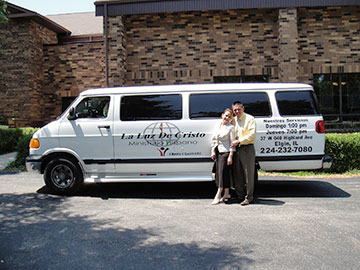 The Riveras pose with the church van.