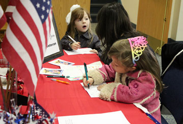 Children at First United Methodist Church, Lancaster, Pa., write thank-you notes to wounded veterans and active troops in the military. A UMNS photo by Gwen Kisker.