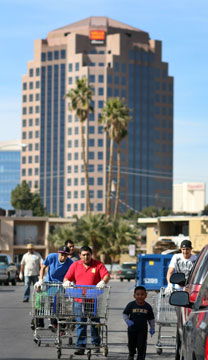 Volunteers for Impact Las Vegas 2013 help clean up the Palos Verdes neighborhood near the Las Vegas Strip. A UMNS photo by Joey Butler.