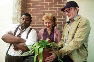 Wegg has settled into college life. Here, at right, he is cast in the school production of