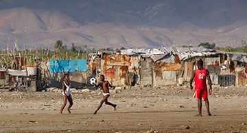 Children play soccer in the Cit Soleil slum of Port-au-Prince, Haiti.
