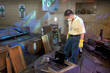 The Rev. Darryl Tate views the ruined sanctuary of St. Luke's United Methodist Church in New Orleans in September 2005.