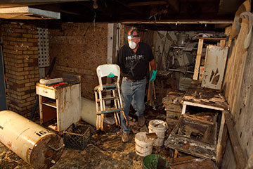 Volunteer Tim Guth helps clean up flood damage at the home of Edward Ortiz in Minot, N.D., in August 2011. He is part of a Volunteers in Mission Team from the Indiana Annual (regional) Conference of The United Methodist Church.  A UMNS file photo by Mike DuBose.