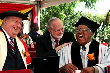 Dr. James Holsinger (center) enjoys a moment with the Rev. John W. Z. Kurewa (right) and the Rev. Roger Ireson before they received honorary Doctor of Letters degrees from Africa University.