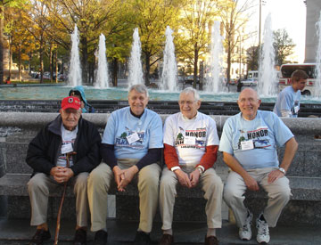 (From left) Ed Schellhaas, Gary Brand, Clancy Biegler, and Charles Barker, all members of Trinity United Methodist Church in Columbus, Ohio, traveled to Washington as part of Honor Flight. Photo by Jeff Fisher.