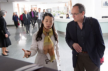 Wang Jiawei (center) shows George Howard of the United Methodist Board of Global Ministries around the library at Nanjing Union Theological Seminary in Nanjing, China. Wang is a professor at the school.