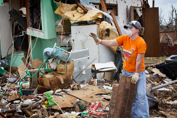 Mel Rogers clears tornado debris at a home in Moore, Okla. Rogers was part of a volunteer team working out of First United Methodist Church in Moore.