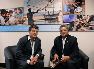 The Rev. Ivan Abrahams (right) and Thomas Kemper, shown here at the United Methodist Board of Global Ministries' office in 2011, praised Nelson Mandela's leadership. A UMNS photo by John C. Goodwin.