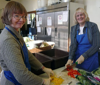 Betsy Comstock and Carolyn Pesheck prepare salad for a Manna Meal in Charleston, W. Va., on Oct. 11, 2010. Manna Meals serves breakfast and lunch 365 days of the year.