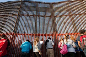 People celebrate the Posada Without Borders at El Faro Park in Tijuana, Mexico, across the border fence from San Diego. A UMNS photo by Mike DuBose.