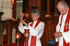 Bishop Peggy Johnson blesses the communion elements during her consecration service at the Northeastern Jurisdictional Conference. A UMNS photo by Suzy Keenan.