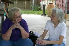 Volunteer Lori Coonce (left) talks with Joyce Mohr, a New Orleans resident whose home was destroyed by Hurricane Katrina. A UMNS photo by Kathy L. Gilbert.