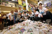 Allegheny students sort through garbage to promote the college's green efforts.
