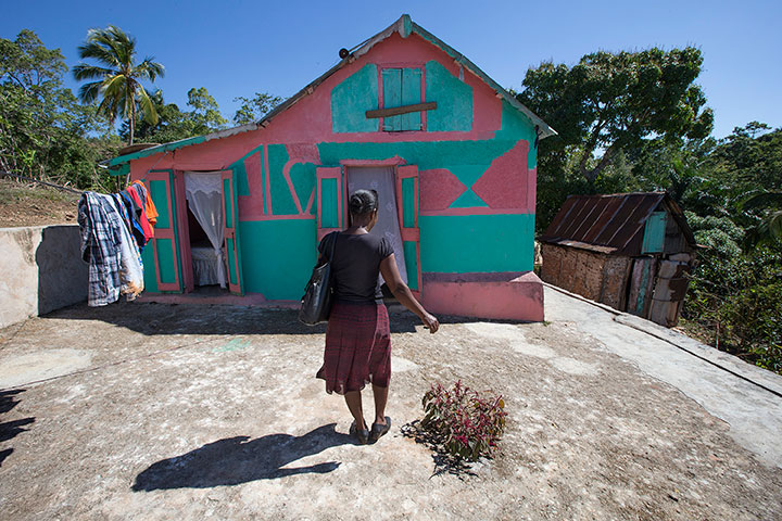 Yolande Gabriel pays a visit to the home of expectant mother Dieula Alrich near Mizak, Haiti.