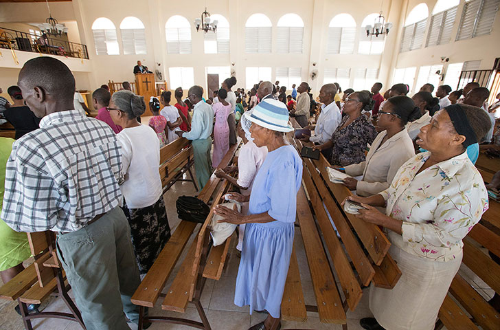 Noelzina Doavil (right) joins fellow parishioners in singing a hymn during worship at St. Martin Methodist Church. Doavil, who was at choir practice when the earthquake hit, and another choir member were trapped in the rubble when the church collapsed.