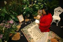 Tauyna  Malone prays in the prayer room at the David L. Lawrence Convention  Center in Pittsburgh during the United Methodist Church's 2004 General Conference.