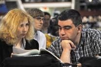 Violetka Zheceva and Samuel Altunian of Bulgaria examine the Daily Christian Advocate during the April 23 organizational session of the 2008 United Methodist General Conference in Fort Worth, Texas.