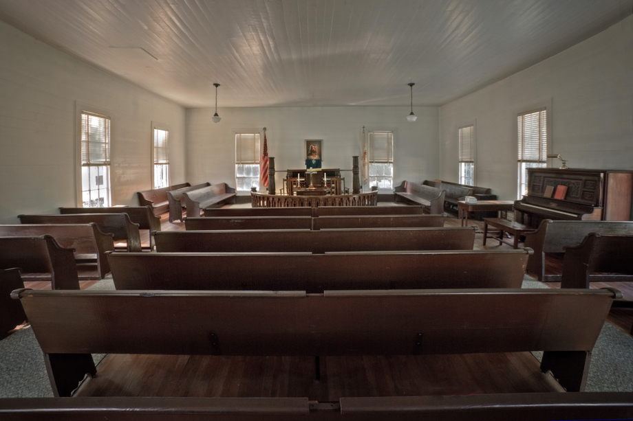 The pews at Union United Methodist Church have mortised notches, from when men sat separately from women and children during worship. Photo by Randall Davis, courtesy Historic Rural Churches of Georgia.