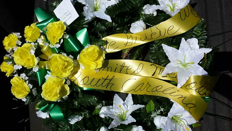A wreath offering sympathy from The United Methodist Church was placed at the police barricade at Emanuel African Methodist Episcopal Church, where nine people were killed during Wednesday night prayer and Bible study. Photo courtesy of Billy Robinson