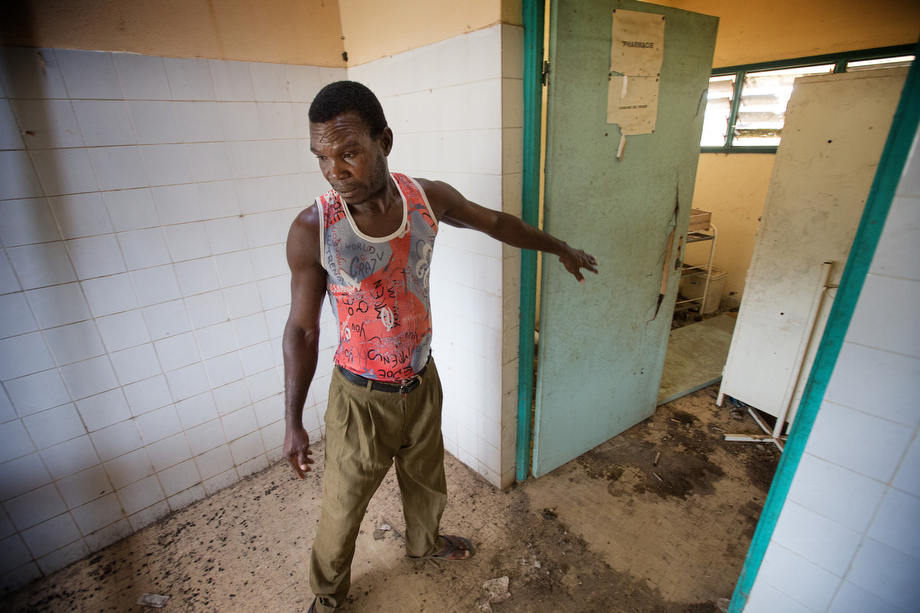 Boh Lion, a fisherman and village elder, walks through the abandoned health clinic in Monogaga. Lion says the clinic has not been used since the doctor left some years ago. The village chief says he hopes The United Methodist Church will reopen the clinic.