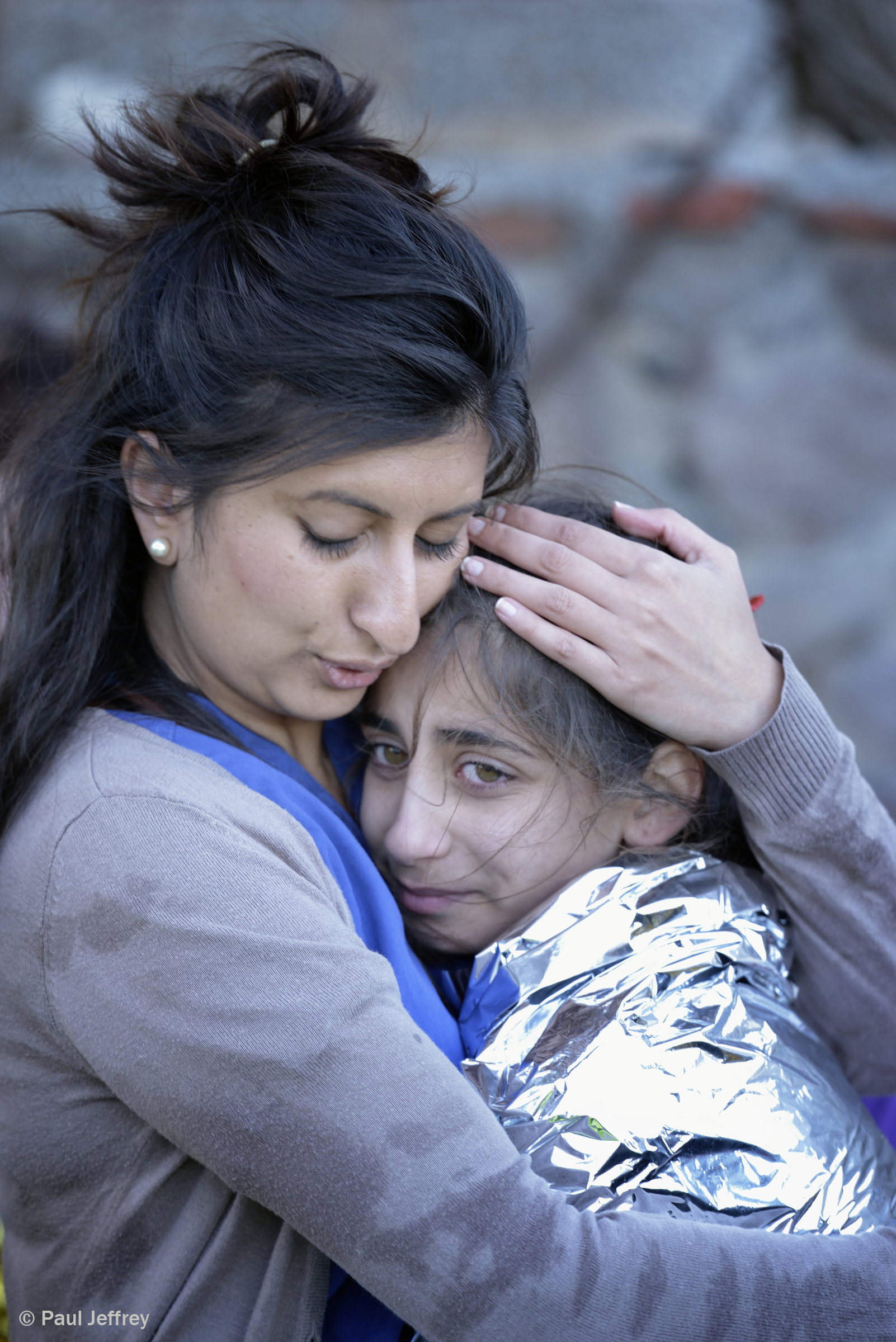 Zoya Hameed hugs a frightened Syrian refugee child