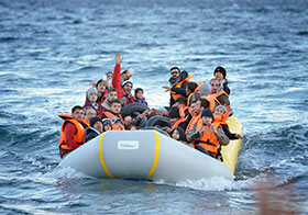 Refugees travel in a rubber boat across the Aegean Sea from Turkey to the Greek island of Lesbos on November 2, 2015.  Photo by Paul Jeffrey