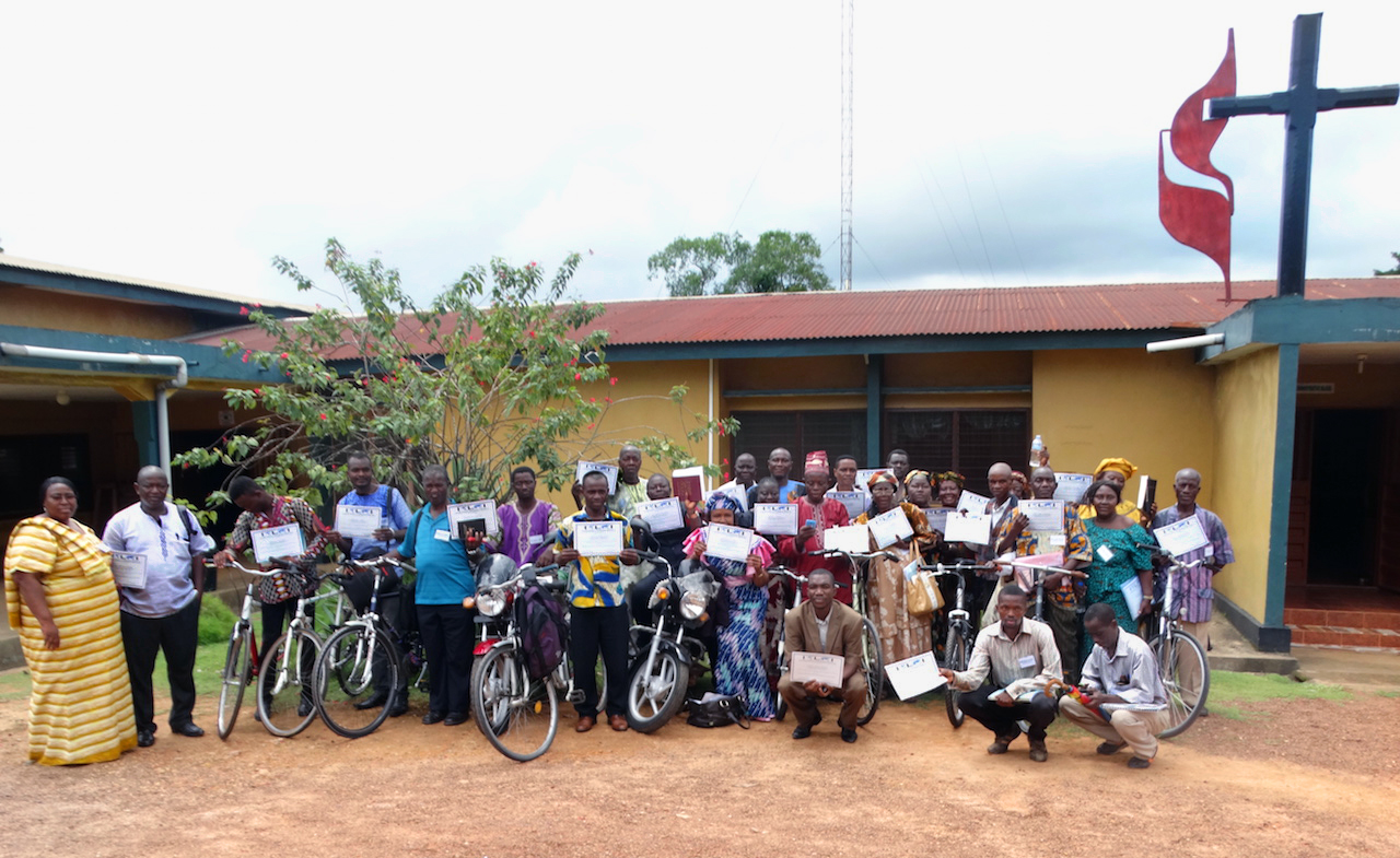 Clergy and lay leaders display their certificates and bikes after a Bikes and Bibles training session at the Child Rescue Center in Bo, southern Sierra Leone. Members of the Anglican Church, United Brethren in Christ and United Methodist Church took part in the training. Photo by Phileas Jusu, UMNS.