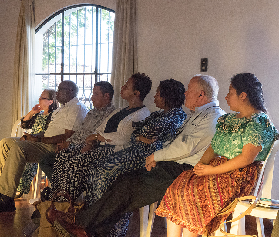 United Methodist bishops and members of the Evangelica Nacional Metodista Primitiva de Guatemala church listen to an overview of Guatemala and Methodism at Santo Tomas Hotel in Chichicastenango, Guatemala. Photo by Kathy L. Gilbert, UMNS.