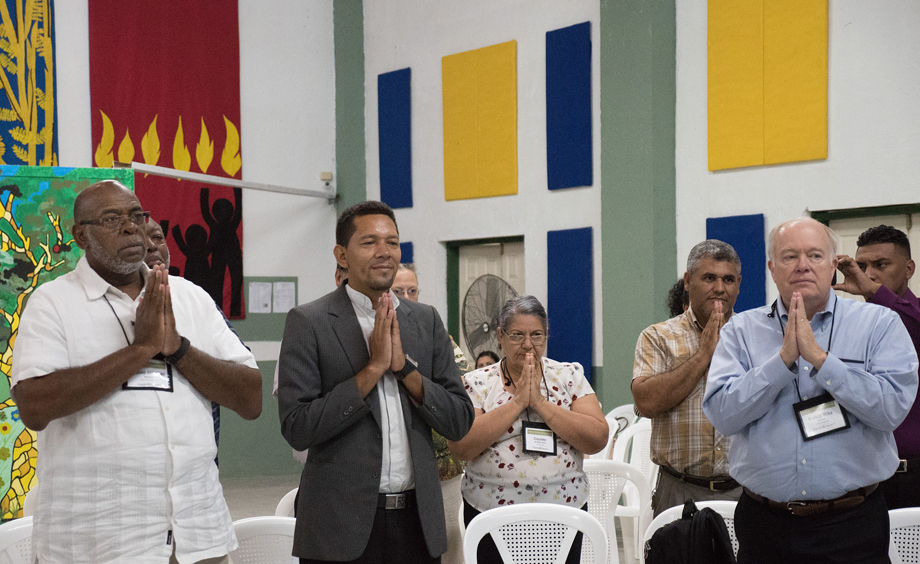 (From left) Bishop Jonathan Holston, the Rev. Carlos Cornejo, Claudete Mora, the Rev. Luis Soto and Bishop Mike McKee use body movement to pray the Lord's Prayer as part of a devotion given by Bishop Cynthia Moore-Koikoi, at Cristo Resucitado, Ciudad España, Honduras.Photo by Kathy L. Gilbert.