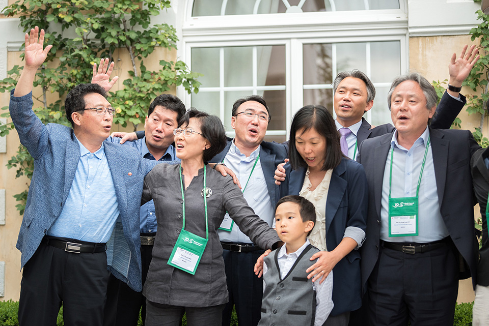 Koreans from both North and South Korean and American Koreans join together in singing a 600 year old Korean folk song about love and reuniting during events of the World Council of Churches. Photo by Albin Hillert, WCC.