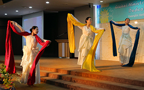 Performers with the Nanumteo Dance Company offer an act of praise,