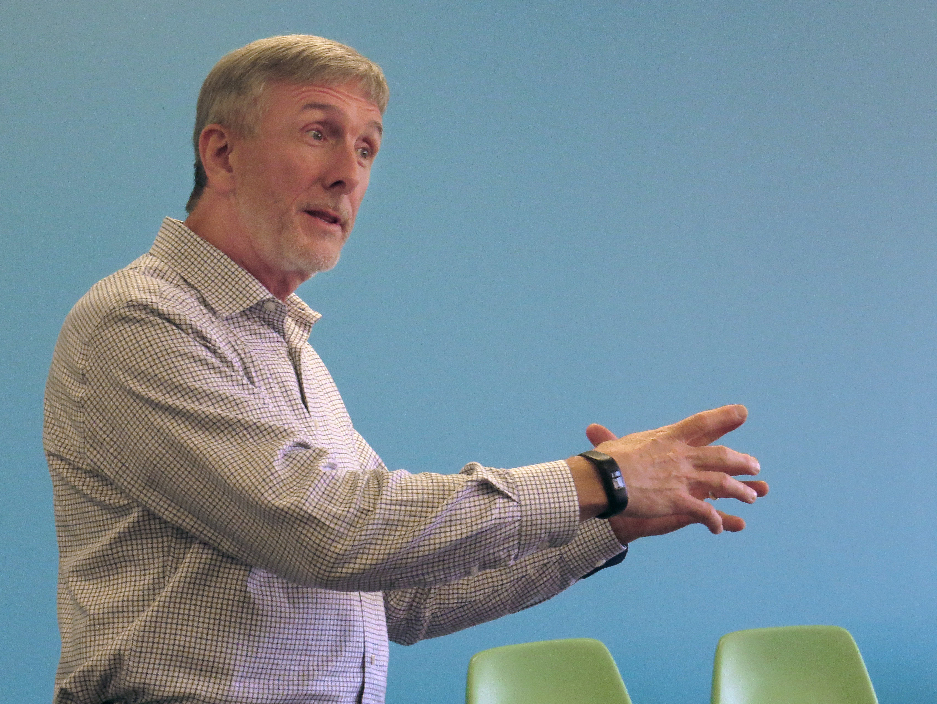 Jonathan Bell speaks on United Methodist microfinance efforts at the Beyond These Walls mission conference. Photo by Sam Hodges, UMNS.