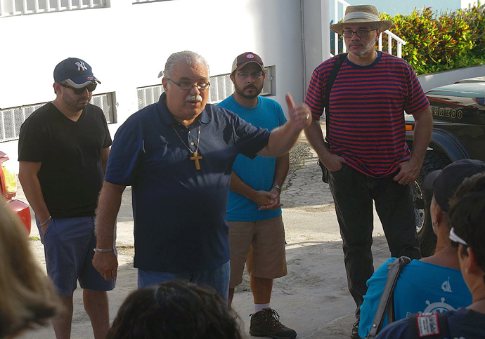 Bishop Hector Ortiz speaks to members of the Methodist Outreach Brigade, who distributed food and water in the central area of Puerto Rico after Hurricane Maria struck the island in September of 2017. Photo by the Rev. Gustavo Vasquez, UMNS.