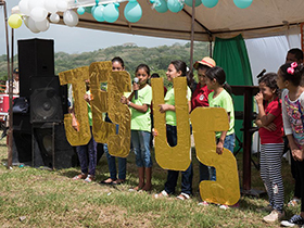Children sang and read scripture behind large letters spelling out Jesus as part of the celebration of placing the cornerstone for Casa de Paz United Methodist Church, San Pedro Sula, Honduras, 2017. Photo by Kathy L. Gilbert.