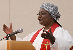Bishop Joaquina Filipe Nhanala helps lead a worship service sponsored by the United Methodist Commission on the Status and Role of Women during the 2016 United Methodist General Conference in Portland, Ore. Photo by Mike DuBose, UMNS.