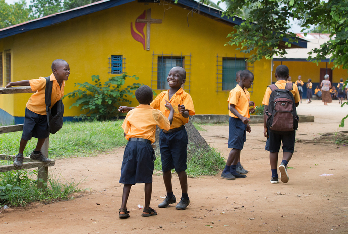 Students enjoy a few moments in the schoolyard before classes begin at the Ganta United Methodist School. Photo by Mike DuBose, UMNS.
