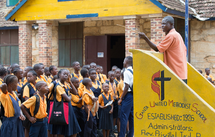 Interim principal James Y. Koroloroblee presides over the morning assembly at Ganta United Methodist School. The school was closed for five months during the 2015-2016 school year due to an outbreak of Ebola. Photo by Mike DuBose, UMNS.
