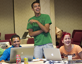 Freddie Bermudez (left), Francisco Nolla (center) and Angélica M. Rivera-Morales share a laugh during the 2012 MARCHA meeting in Lake Junaluska, N.C. Photo by Mike DuBose, UMNS.