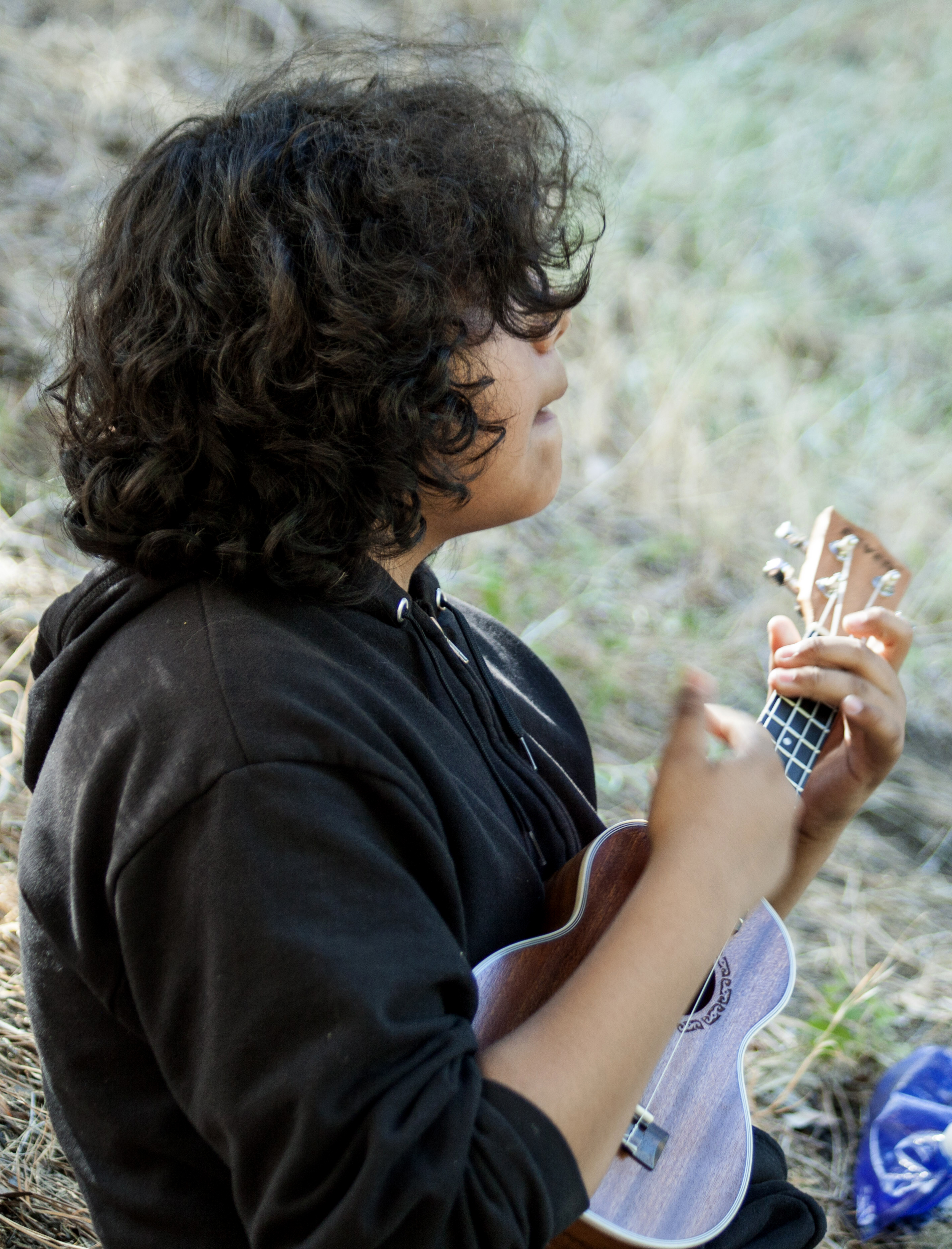 A young boy plays ukele at United Methodist Camp Colby. Photo courtesy of California-Pacific Conference.