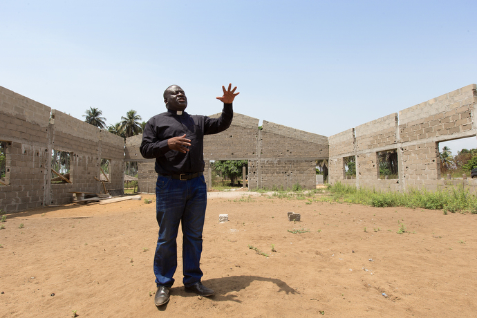 The Rev. Jean Claude Masuka Maleka hopes to raise funds that would allow him to complete construction of a new United Methodist church in the village of Akrou, Côte d'Ivoire. The station remained on the air during the crisis and several staffers took shelter there. Photo by Mike DuBose, UMNS.